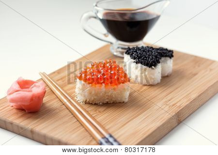 Two heart shaped sushi with salmon roe and beluga caviar