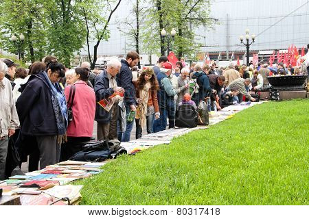 Participants Of Communistic Procession Consider The Political Press And Books