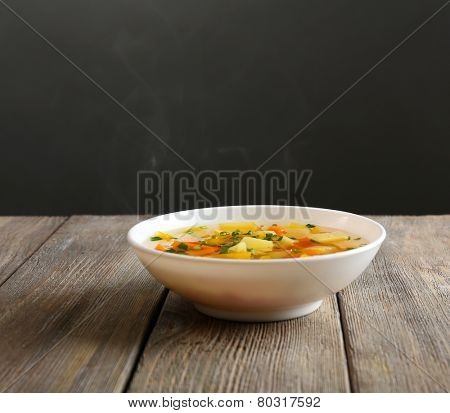 Delicious home cooked food with steam on table on grey background
