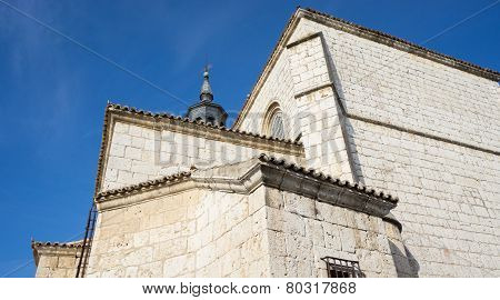 Cathedral with stone wall and blue sky