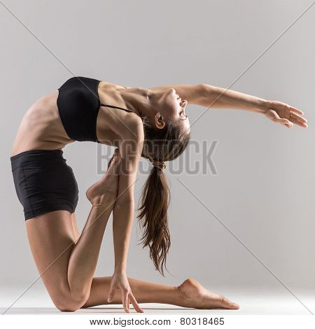 Yogi Gymnast Girl Doing Asana Ustrasana Or Camel Pose