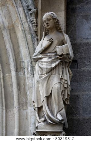 VIENNA, AUSTRIA - OCTOBER 11: Statue of Saint, facade of Minoriten kirche in Vienna, Austria on October 11, 2014.