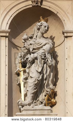 VIENNA, AUSTRIA - OCTOBER 10: Saint Catherine of Alexandria on baroque Jesuits church. The church was built between 1623 and 1627. in Vienna, Austria on October 10, 2014.