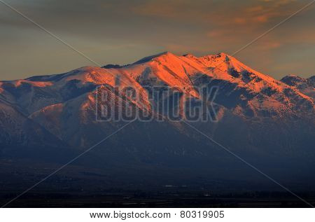 Landscape of tall mountain with glowing sunlight from sunset or sunrise