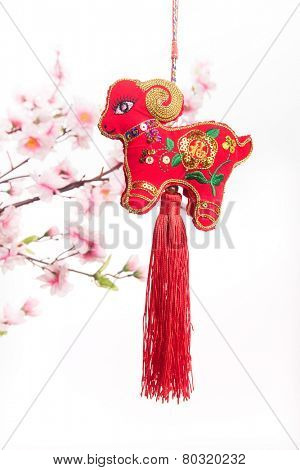 chinese goat knot on white background, word for