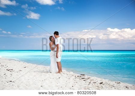 Newlyweds In Love On White Sandy Beach