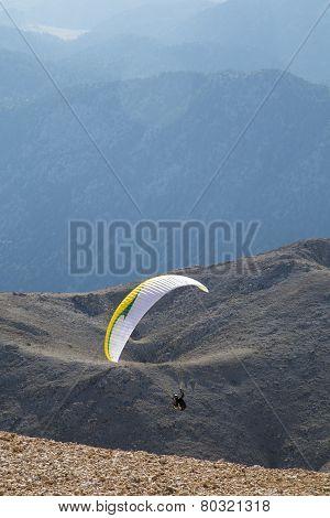 Paraglider Flying Against Tahtali Mountain Near Antalya