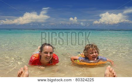 Mother And Son Enjoying A Tropical Beach