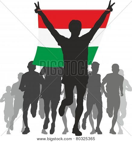 Athlete with the Hungary flag at the finish
