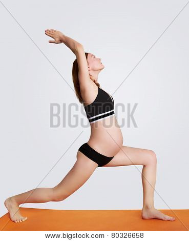 Pregnant woman doing yoga and relaxing
