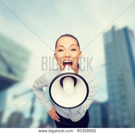 business and office concept - screaming businesswoman with megaphone