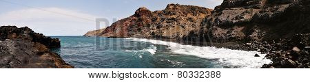 Waves Under Rugged Coastline