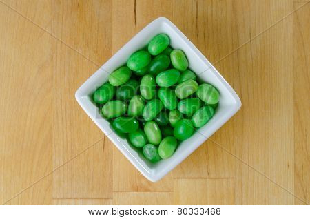 Green Jelly Beans In White Bowl