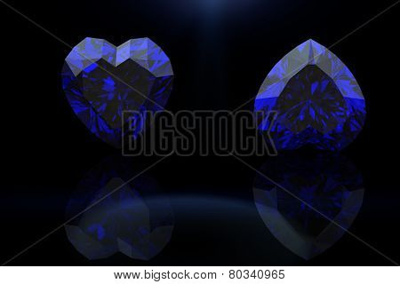 Heart shape gemstone. Collections of jewelry gems on black. Sapphire