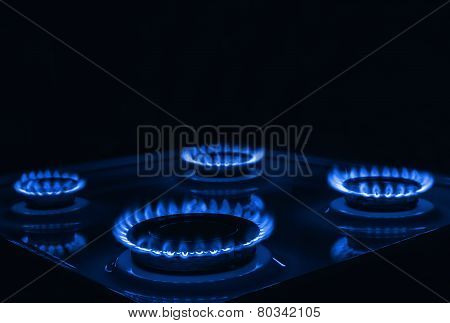 Blue Flames Of Gas Burning From A Kitchen Gas Stove With Space For Text On Top
