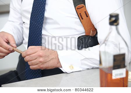 Man holding in hand cigar