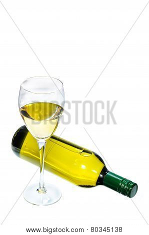 Glass Of White Wine With Bottle