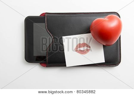 Heart And Kiss With Notebook On White Abckground