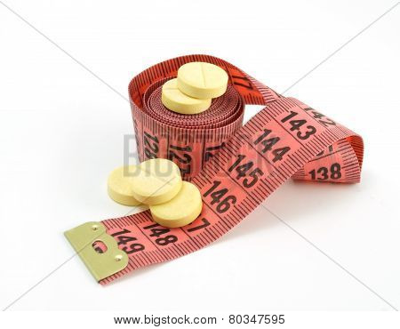 Measuring tape and pills. supplements of weight loss