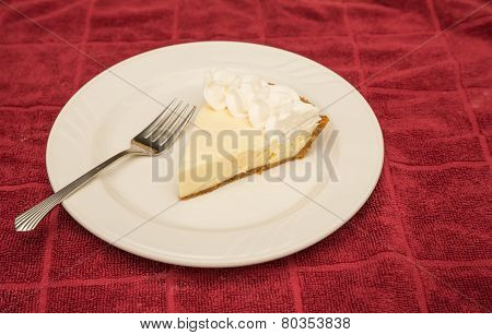 Slice Of Lemon Meringue Pie On Red Towel