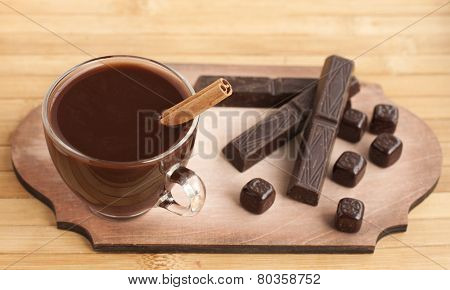 Hot Chocolate With Cinnamon And Spices In A Glass Cup And Chocolate Bars.