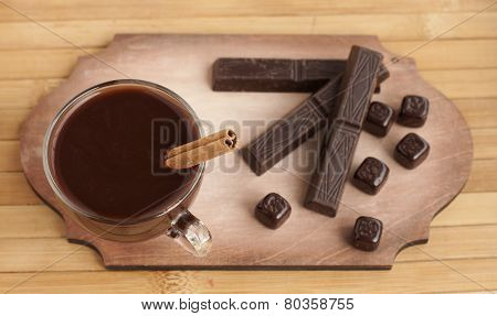 Hot Chocolate In A Glass Cup And Chocolate Bars.
