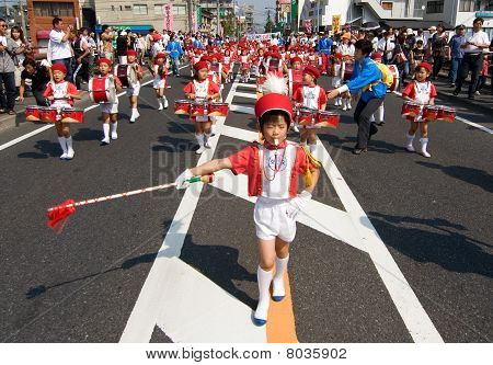 Young Japanese Boy Leading A Children's Marching Band.
