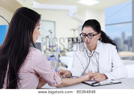 Female Patient Checked By Doctor