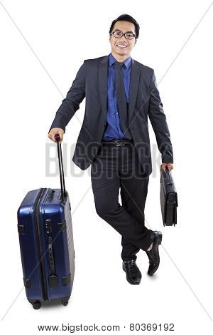 Male Worker Carrying Luggage And Briefcase