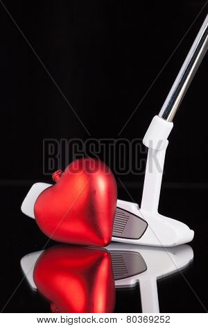 Golf Putter And Love Symbol On The Black Glass Desk