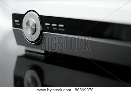 Silver Volume Controller On Front Side Of Dvd Player