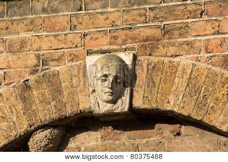 Face On Key Stone
