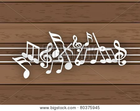 Musical notes with line on wood background.
