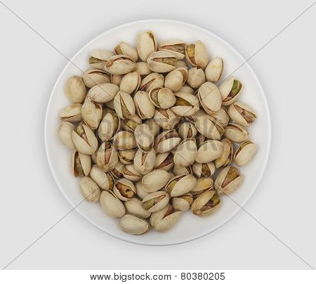 Roasted Pistachio Nuts On A White Plate