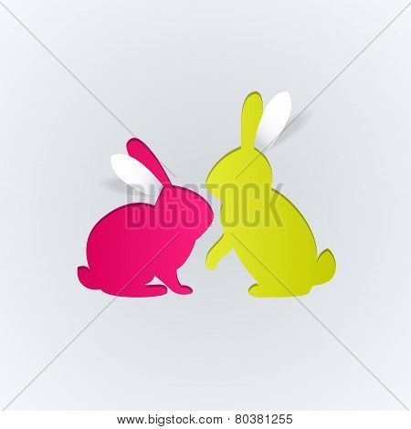 Couple of paper rabbits on a white background
