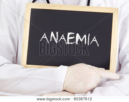 Doctor Shows Information On Blackboard: Anaemia