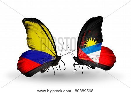 Two Butterflies With Flags On Wings As Symbol Of Relations Columbia And Antigua And Barbuda