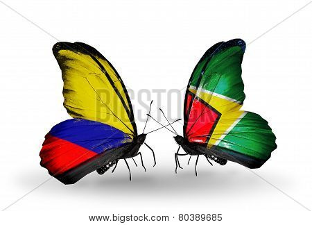Two Butterflies With Flags On Wings As Symbol Of Relations Columbia And Guyana