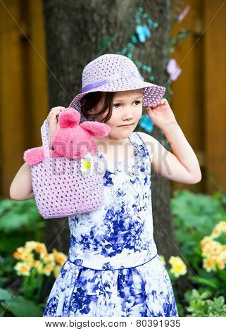 Little Girl Holding A Hand Bag With An Easter Bunny