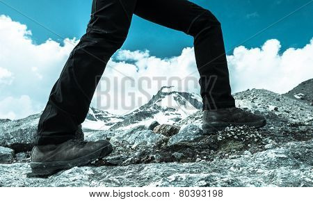Close-up Of Hiking Shoes On Mountain Ridge.