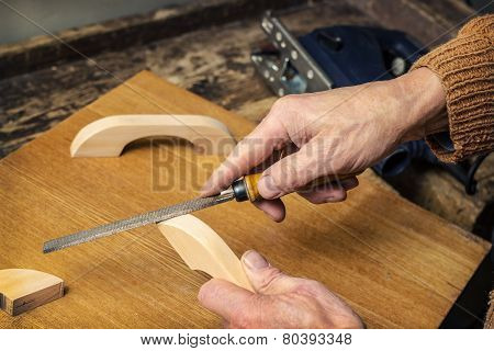 Carpenter Working In A Workshop Rasp