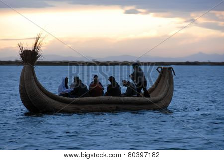 Riders In A Reed Boat Around Lake Titicaca, Peru