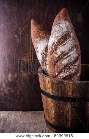A loaf of fresh rustic wholemeal rye bread.