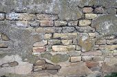 pic of fortified wall  - The old dilapidated wall on one farmhouse - JPG