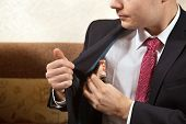 stock photo of white collar crime  - Russian businessman is receiving a bribe in rubles - JPG