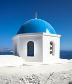 picture of cupola  - Traditional church with blue cupola at Oia Village Santorini island in Greece - JPG