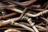 stock photo of exhaust pipes  - Pile of rusty old exhaust pipes - JPG