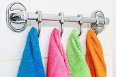 picture of pinafore  - colored towels hanging on the rack in the bathroom - JPG