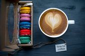 picture of biscuits  - Coffee cup with heart shape and macaroons biscuits on the dark wooden table - JPG