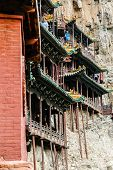 stock photo of grotto  - Buildings on the cliff in Yunmen Grotto in China - JPG